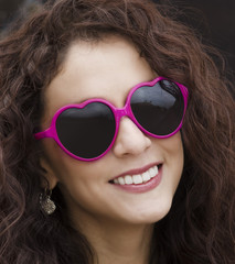 Happy playful smiling woman wearing sunglasses