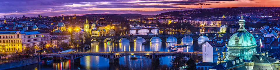 Spoed Fotobehang Praag Bridges in Prague over the river at sunset