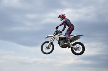 MX participant on a motorcycle in the air