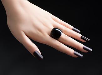 Manicured Nail with Black Matte Nail Polish. Fashion Manicure