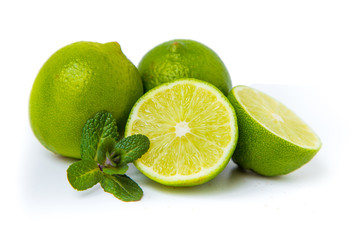 Citrus lime fruit isolated on white background with mint