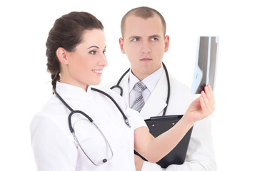 young female and male doctors with xray isolated on white