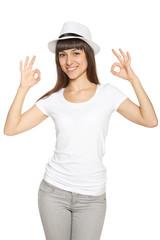 Happy young yoman gesturing OK