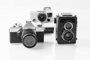 Three vintage analogue cameras