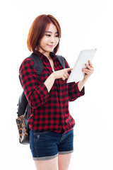 Young Asian student woman using a pad PC