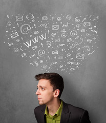 Businessman thinking with social network icons above his head