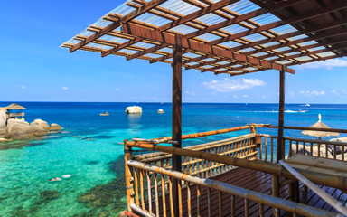 Bamboo hut over crystal clear sea