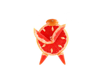 Healthy eating. Funny alarm clock made of the grapefruit slices.
