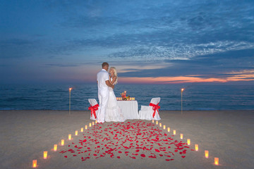 couple share a romantic dinner with candles