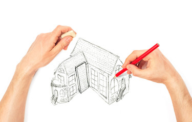 Hands drawing big house on a white
