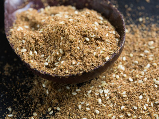 Za'atar spice in a wooden spoon