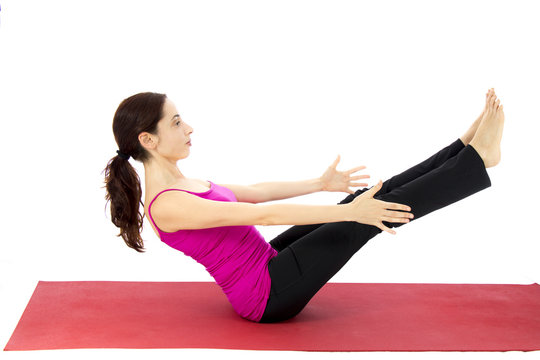 Woman doing a boat pose variation in yoga