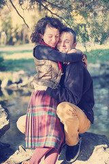 Loving couple hugging in the park