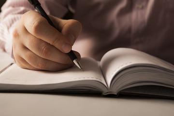 man is preparing for written work