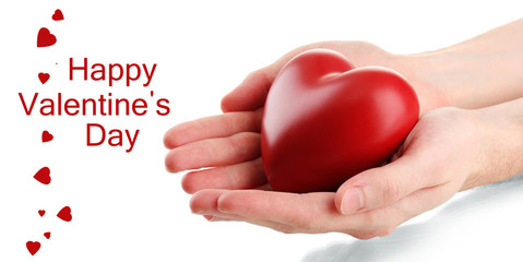 Fototapete - Red heart in man hands, isolated on white