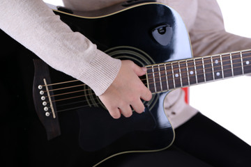 Acoustic guitar in female hands, isolated on white