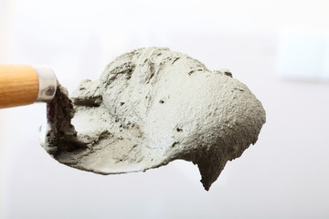 Close up bucket trowel with cement mortar
