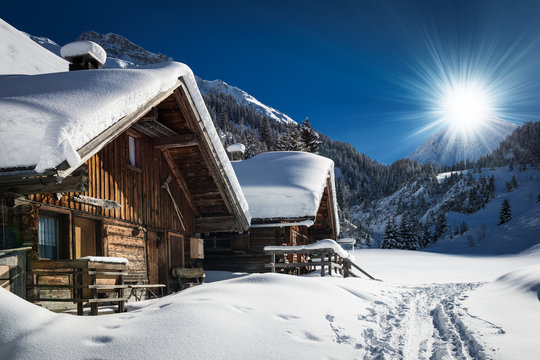 winter ski chalet and cabin in snow mountain  landscape in tyrol
