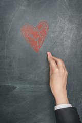 Hand with chalk drawing a heart