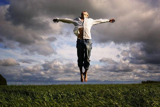 man flying freedom yoga meditation