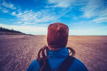 Hiker looking at blue sky