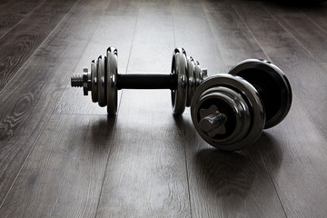 dumbells on wooden floor