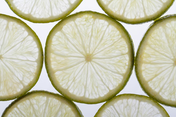 Sliced ​​into thin slices fresh lime. macro. close-up