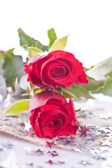 two red rose with silver star