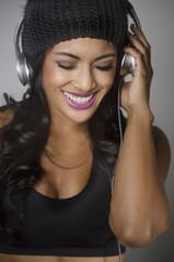 Beautiful young woman enjoying music