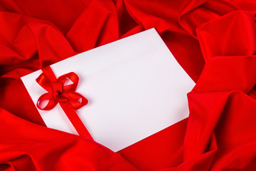 love card with ribbon on a red fabric