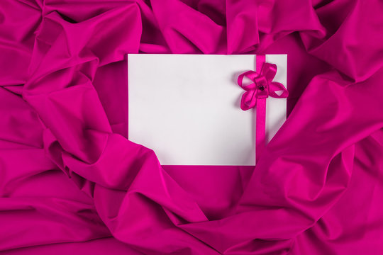 love card with ribbon on a purple fabric