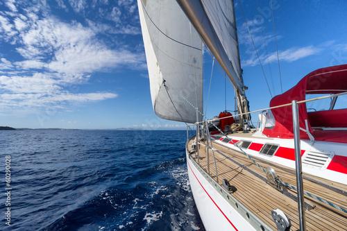 Fototapete Sailing yacht in blue sea