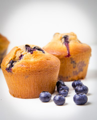 Wall Mural - Couples of blueberry muffins on white background