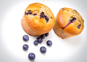 Wall Mural - Blueberry muffins on white background