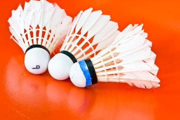 Three shuttlecock badminton on a orange background