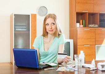 Blonde woman choosing medication online