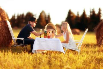 lovers picnic in field