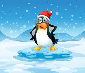 A penguin wearing Santa's hat standing above an iceberg