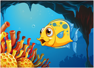 A big yellow fish under the sea inside the sea cave