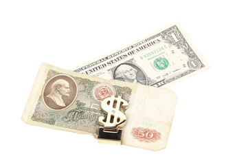 Ruble and dollar banknotes in money clip.