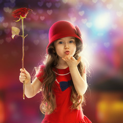 Little girl with rose sends kiss