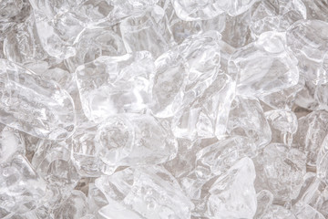 Ice cubes background close up view
