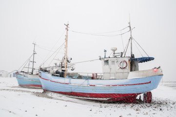 Fisherboats in the snow