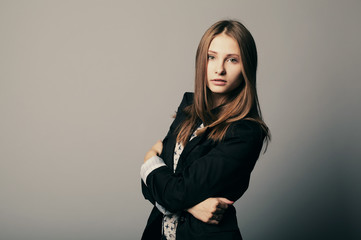 Fashion girl posing in grey background