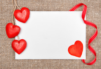 Valentine card with drawing heart and wooden hearts