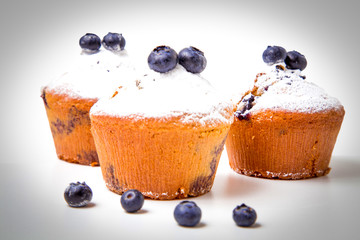 Fototapete - Blueberry muffins with powdered sugar