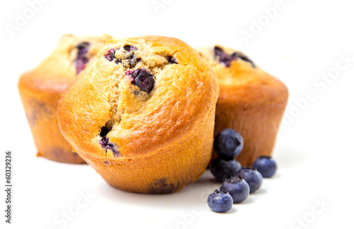 Wall mural Muffins with blueberry on white background