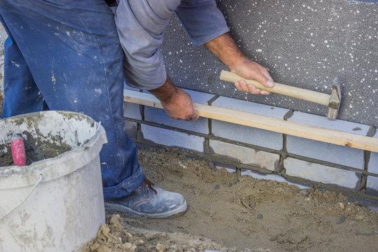builder worker installing insulation layer 4