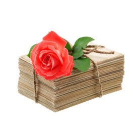 old love letters and postcards with red rose flower