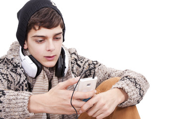 Teen chatting with mobile phone